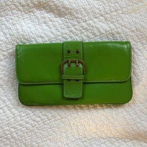 Green clutch bag